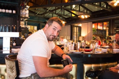 Joey Fatone holding a Wocket smart wallet August 5th, New York City.